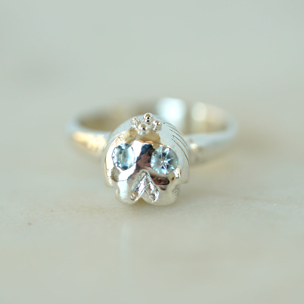 Memento Mori Silver skull ring with aquamarines