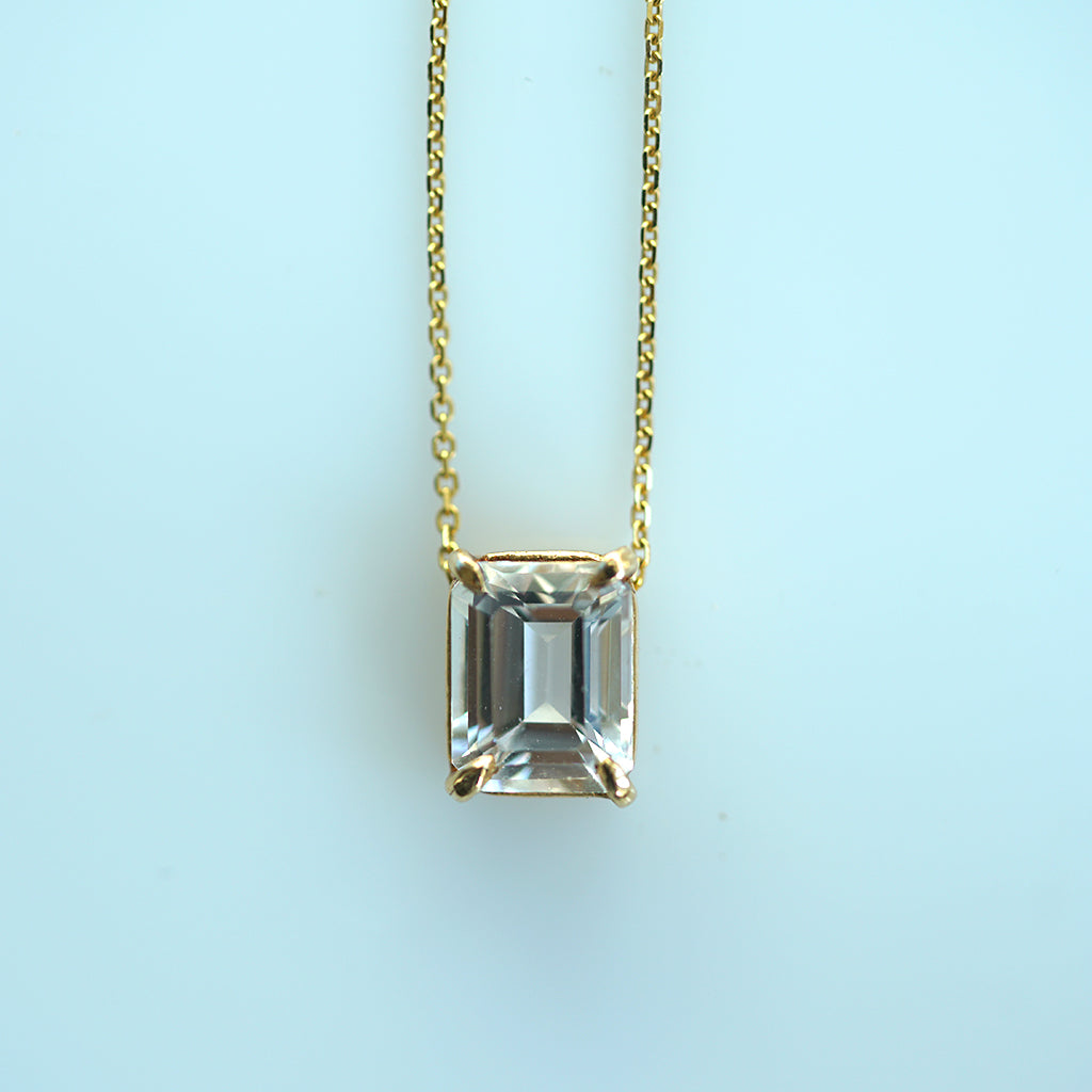 White topaz emerald cut gold necklace