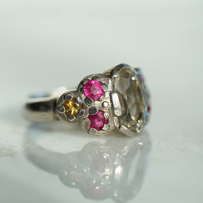 Cocktail ring with white topaz and rubies