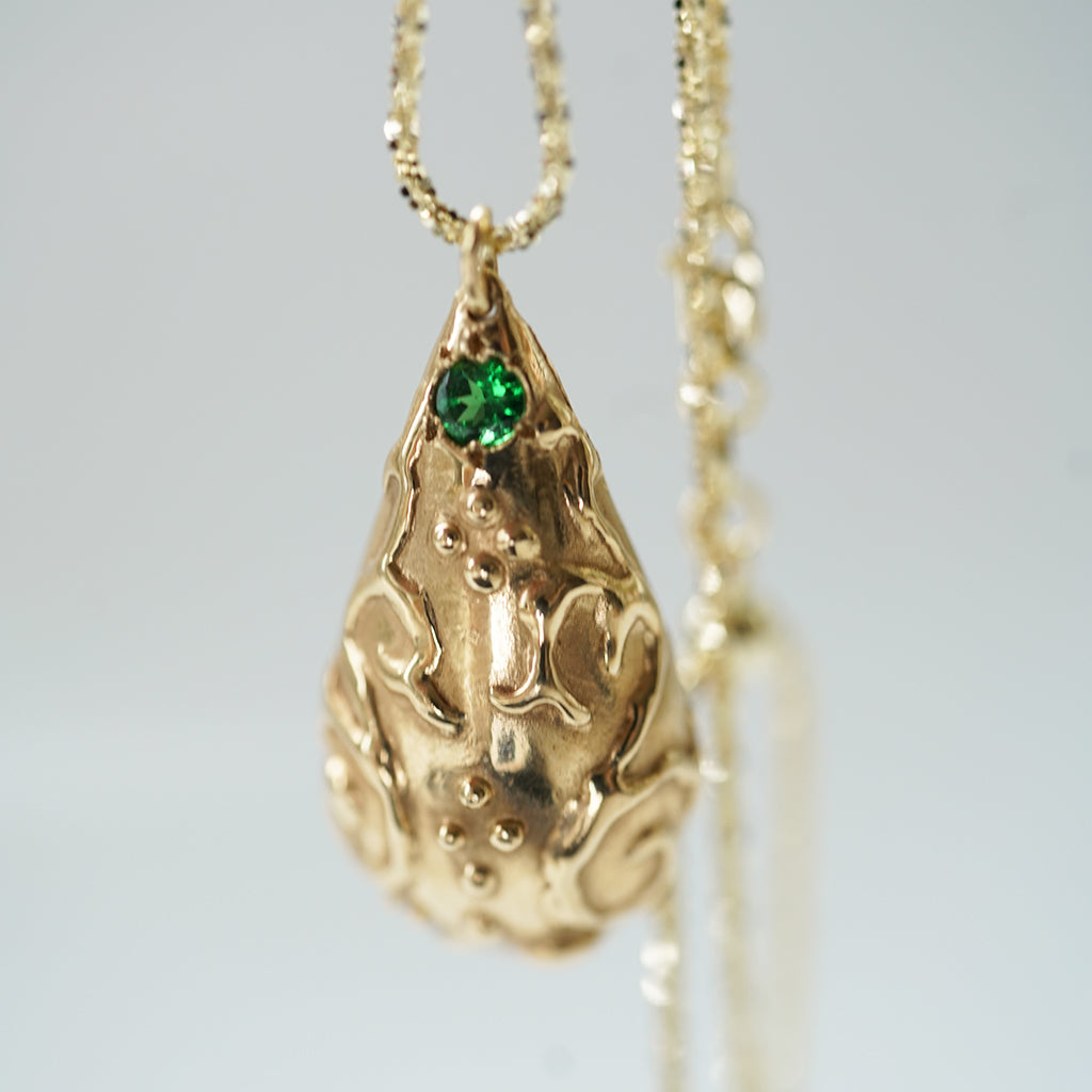 Pear Shape gold romanesque necklace with tsavorite