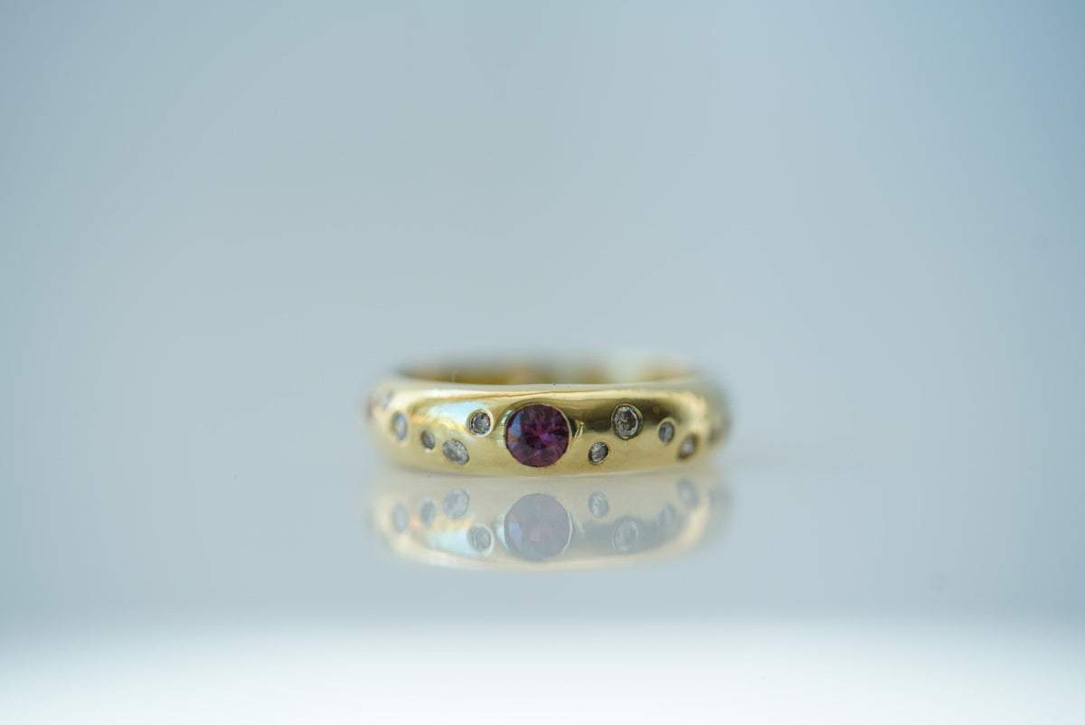 18ky gold band with diamonds from Joy and rubies