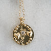 Love medallion necklace in gold with diamond