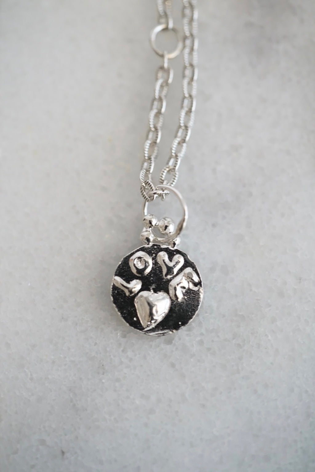 Love medallion necklace in silver