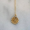 Small dots gold medallion