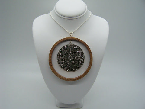 "2"" recycled wood circle with flowery metal pendant"