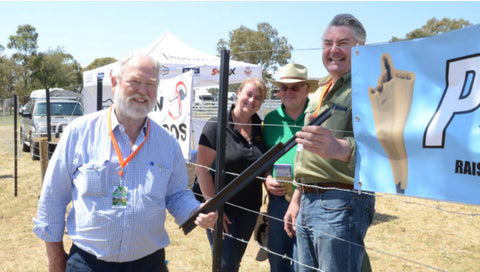 Fraser Old (left) and Ian Lowrey (right) show the PickeX plastic extension made of recycled PVC that will instantly raise the height of a picket fence to visitors Debbie and Graham Higham, Kamaroo Angus, Trunkey Creek.  Aa