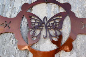 laser cut metal cross with butterfly in center and barbed wire cutouts