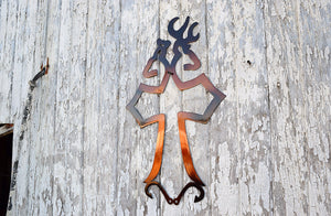 metal sign in shape of cross with buck and doe at top and fishing hooks at the bottom