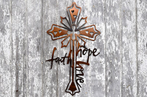 "laser cut metal art depicting a cross with the wrods, ""faith, hope, love"""
