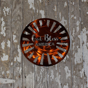 "laser cut metal sign with a star and rays within a circle frame and the words ""God Bless America"" in the middle"