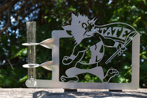 A stainless steel rain gauge with old school Willie Wildcat