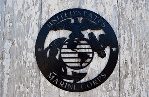 "laser cut metal art shaped in a cirle with the Marine Corps emblem in the center and the words, ""United States Marine Corps"" around the perimeter"