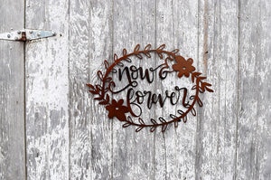 "laser cut metal art of a floral wreath and the words, ""Now & Forever"" in the center"