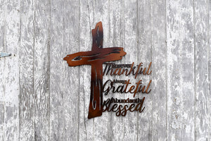 "laser cut metal art of a wooden cross and the phrase, ""Forever thankdful, Always Grateful, Abundantly Blessed"""