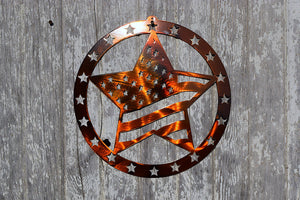 laser cut metal art with a circle of stars around a larger star with a design that mimics the U.S. flag