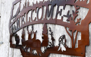 "metal sign with wild life scence including, deer, pheasant, turkey, ducks, hunting dog and the word ""welcome"""
