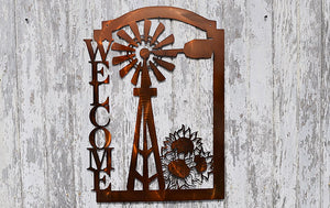 Welcome sign with windmill and sunflowers