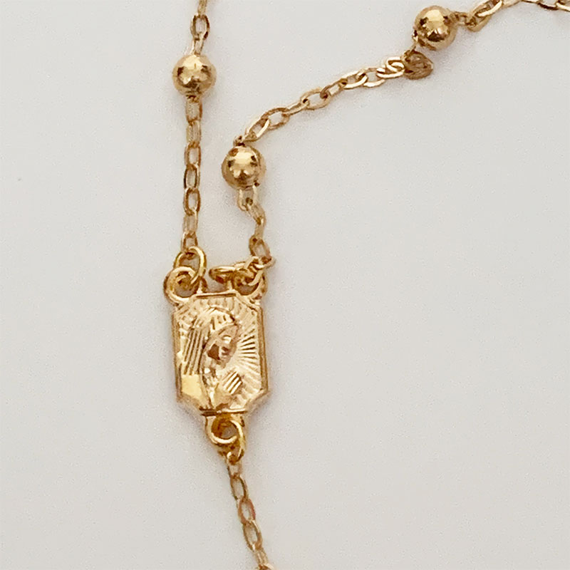 Close up of Gold Rosary Necklace | Gothic Grace