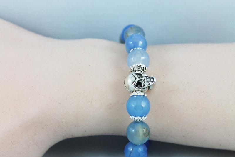 Silver Skull Blue Gemstone Stretch Bracelet - Gothic Grace