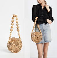 Woman holding Circle Bamboo Basket Handbag with Beaded Shoulder Strap
