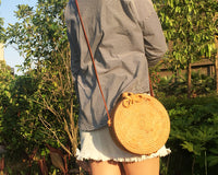 Handmade Round Rattan Bali Bag with Woven Star Pattern