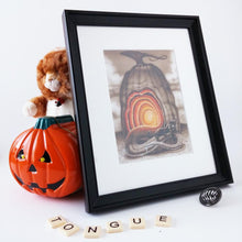 "Load image into Gallery viewer, Red Fracture - Original - Cat on a hot tin tongue - Pictured, a stuffed cat and a pumpkin shaped tin. Also, the word ""tongue"" in scrabble tiles."