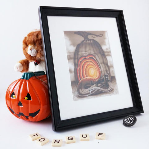 "Red Fracture - Original - Cat on a hot tin tongue - Pictured, a stuffed cat and a pumpkin shaped tin. Also, the word ""tongue"" in scrabble tiles."