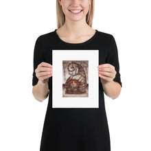 Load image into Gallery viewer, Red Fracture - The truth about cats and pumpkins - Purr - Pictured, a lady holding up a poster print of Sean Chappell's Purr. $19.95