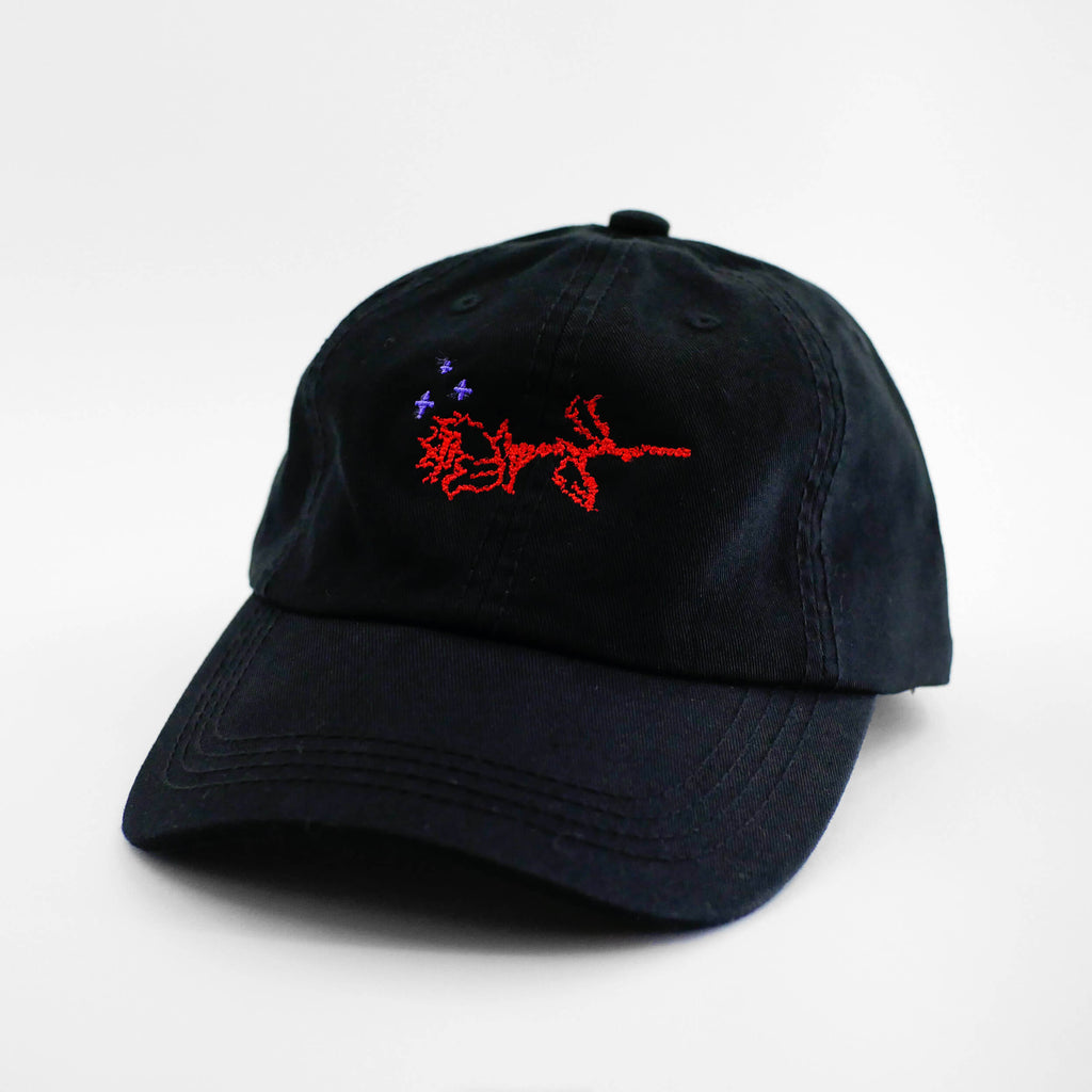 Angle view of the embroidered ASCII Rose black dad hat from PHOSIS Clothing