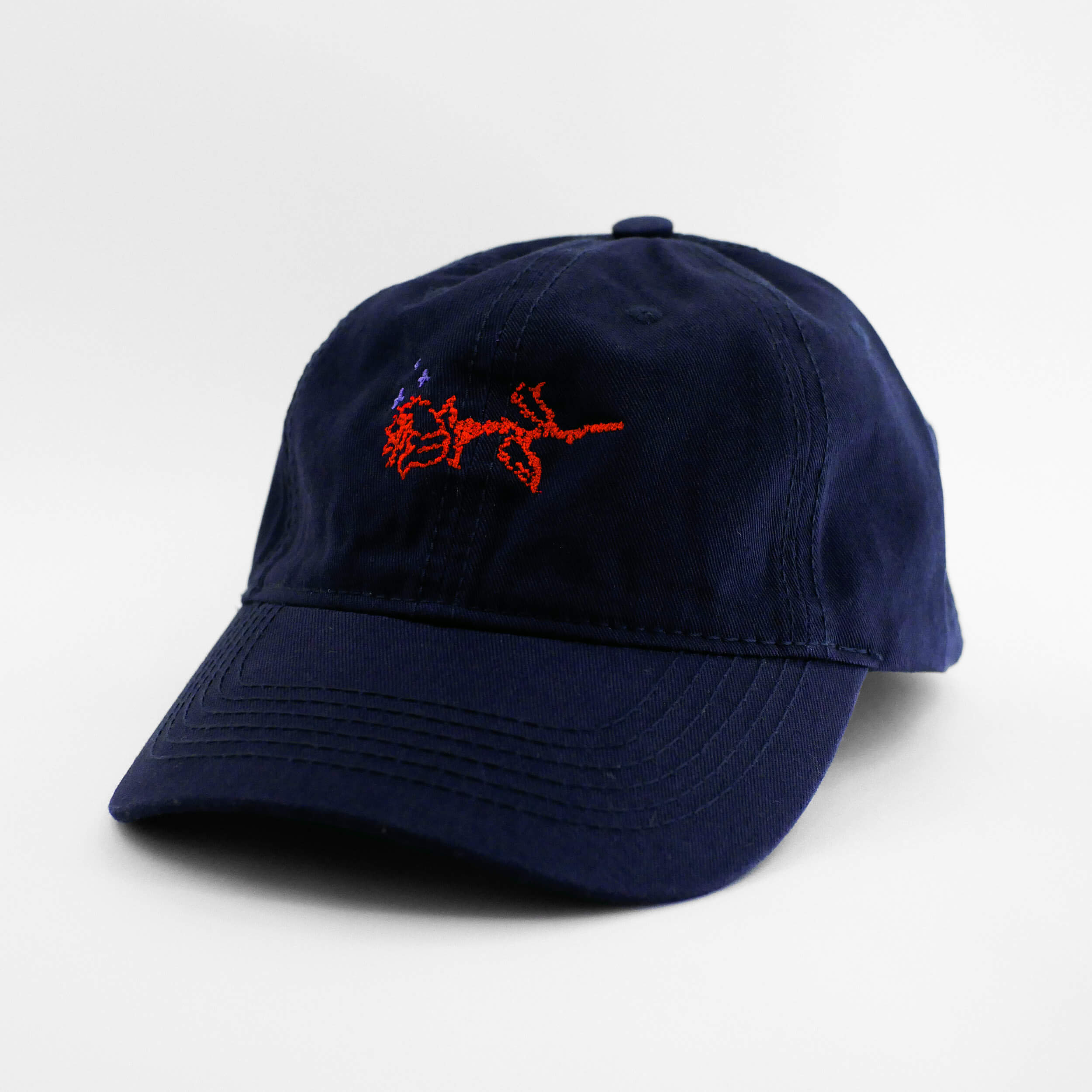 Angle view of the embroidered ASCII Rose navy blue dad hat from PHOSIS Clothing