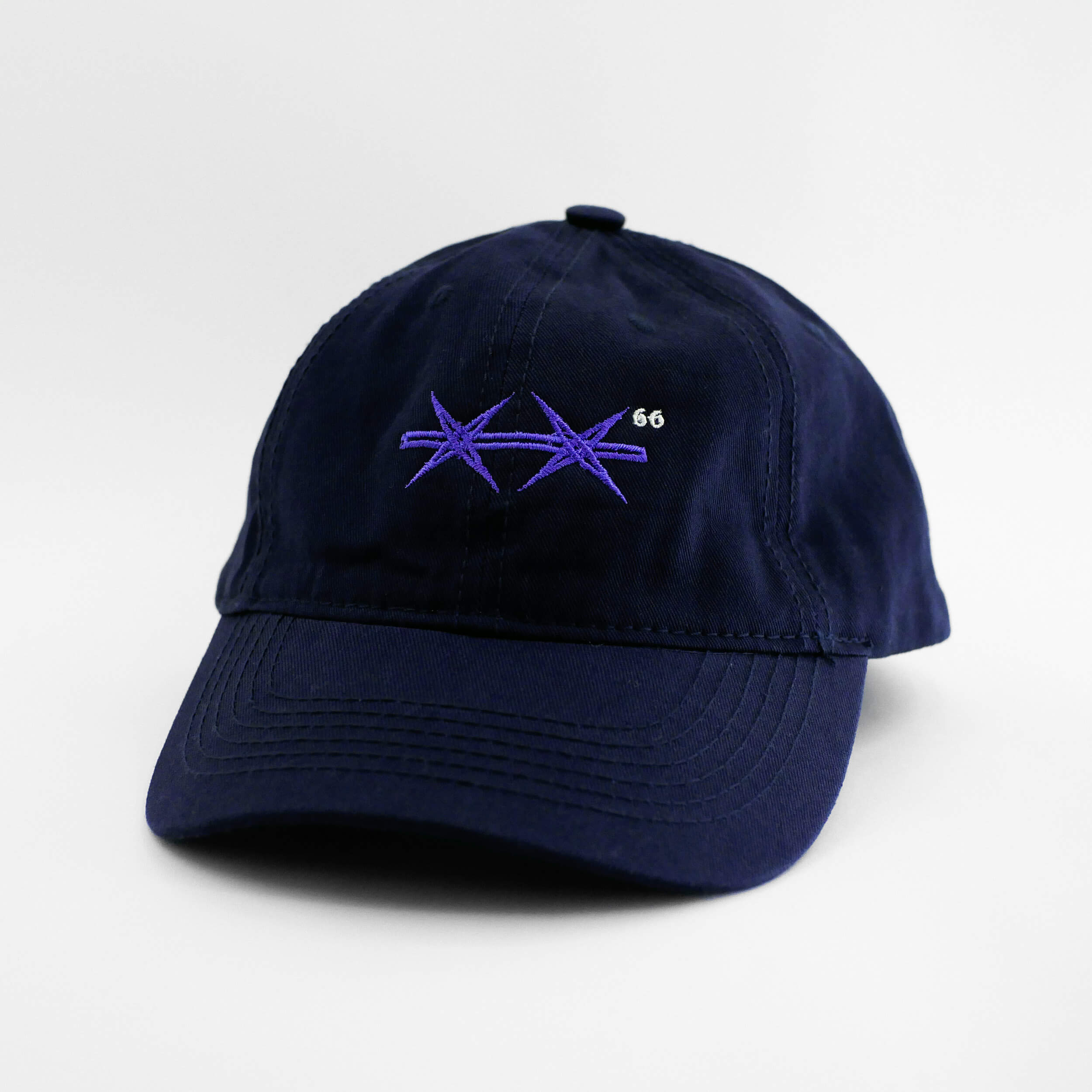 Angle view of the embroidered Barbed Wire navy blue dad hat from PHOSIS Clothing
