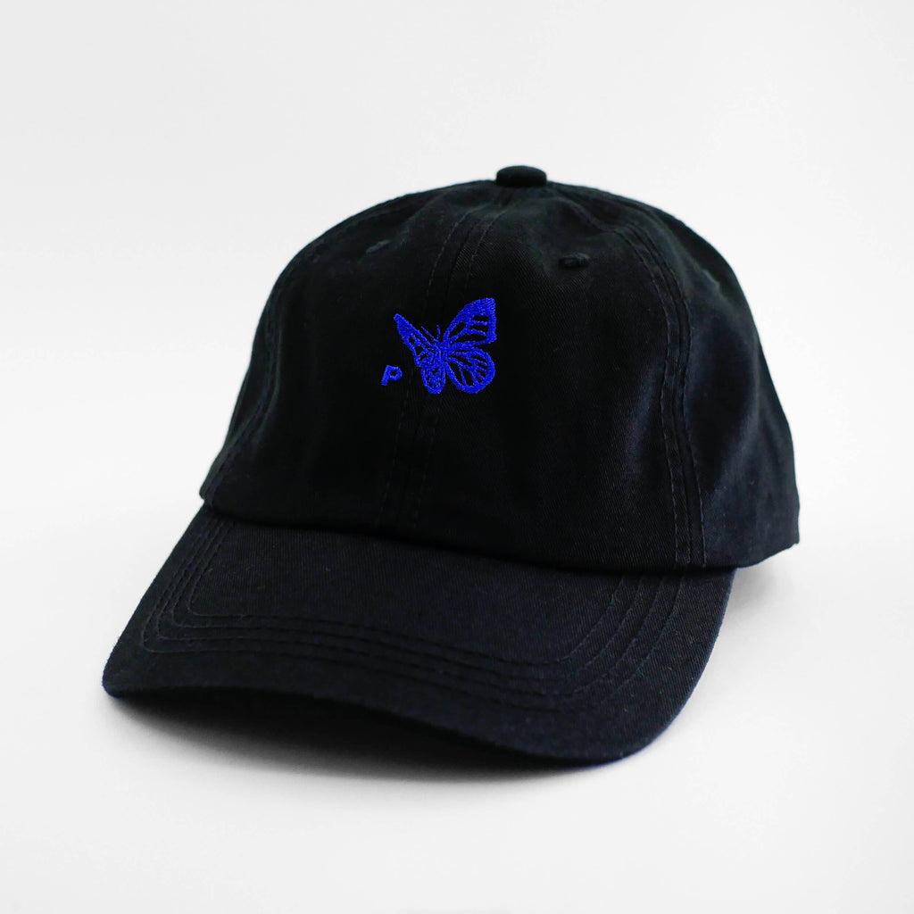 Angle view of the embroidered Buttterfly Logo black dad hat from PHOSIS Clothing