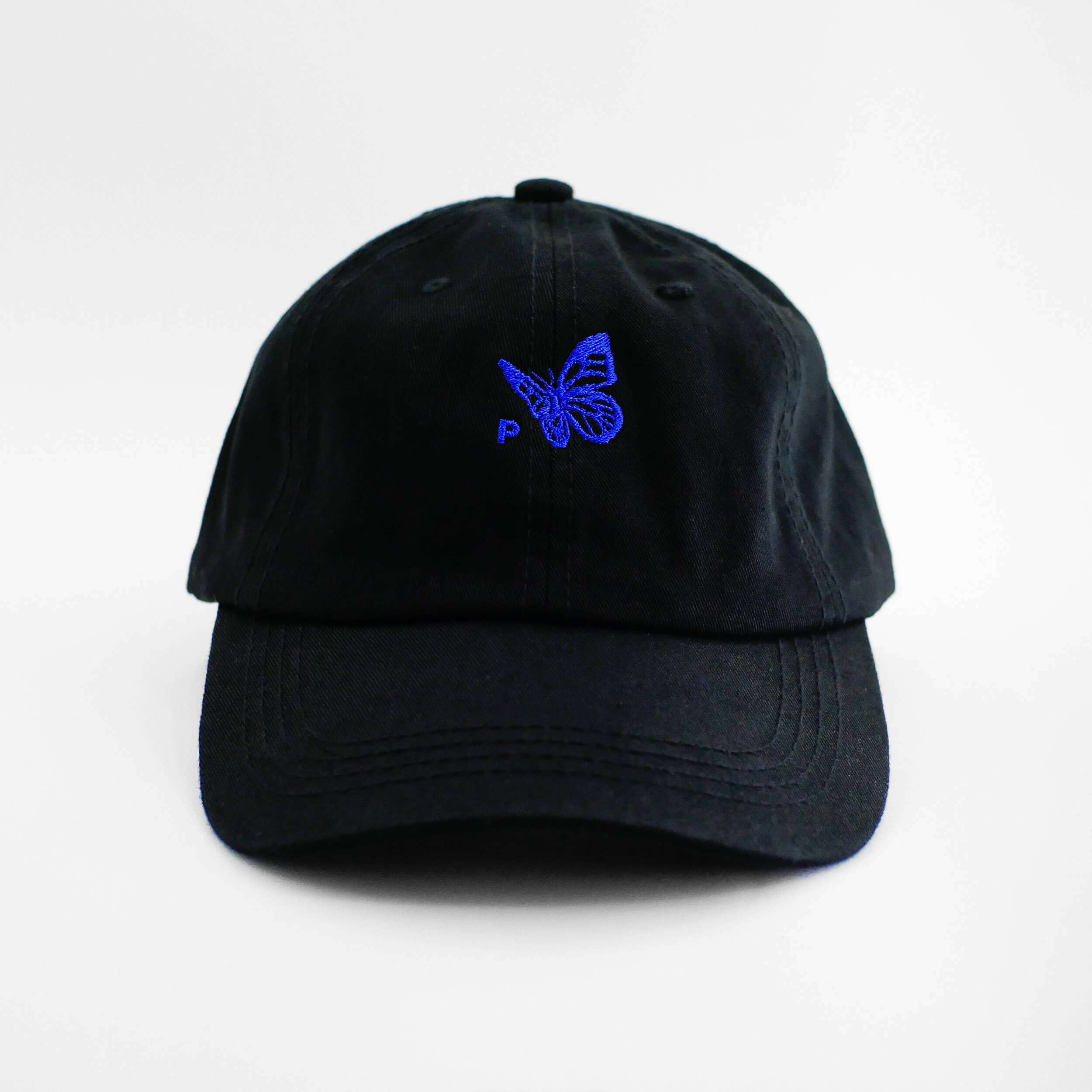 Front view of the embroidered Buttterfly Logo black dad hat from PHOSIS Clothing