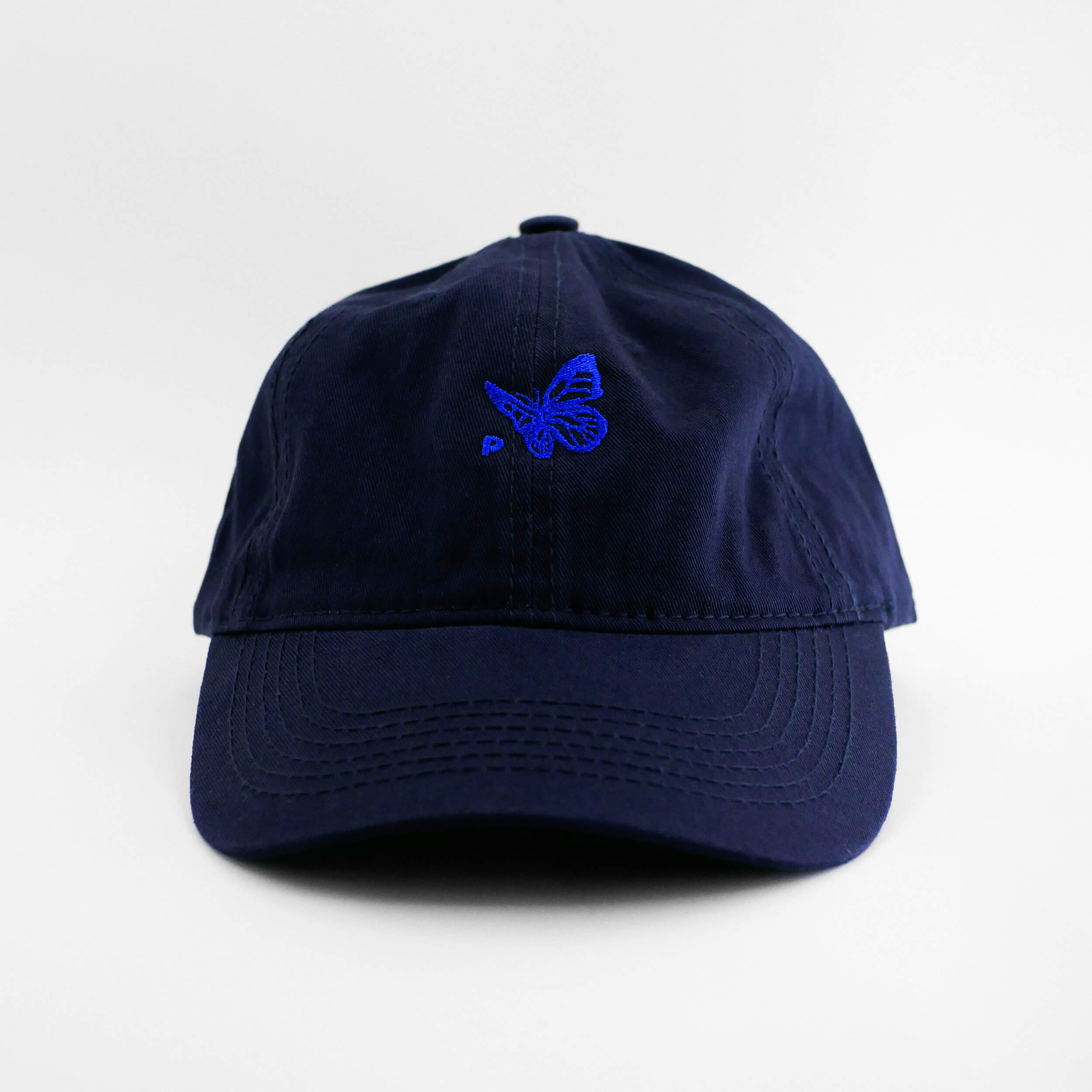 Front view of the embroidered Buttterfly Logo navy blue hat from PHOSIS Clothing