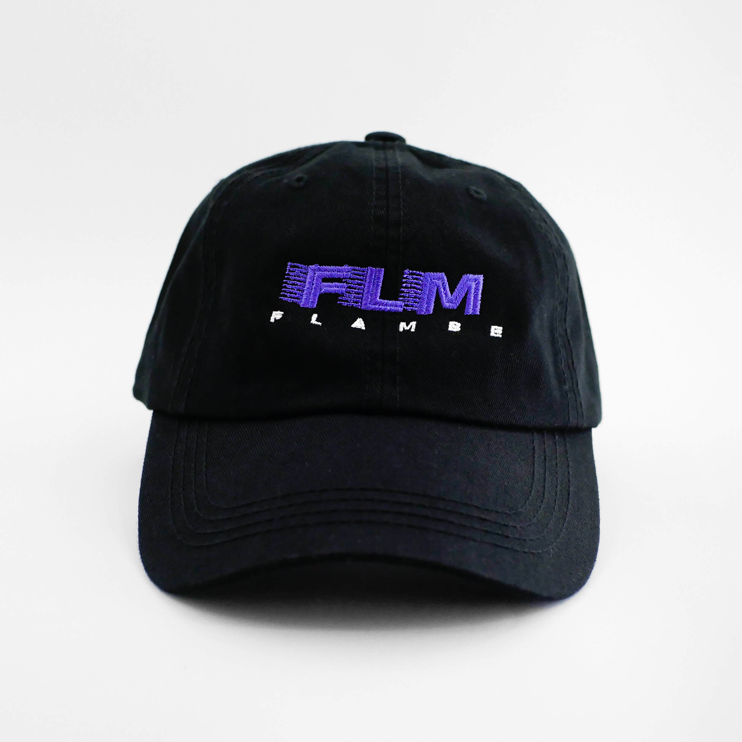 Front view of the embroidered 'FLAMBE' black dad hat from PHOSIS Clothing