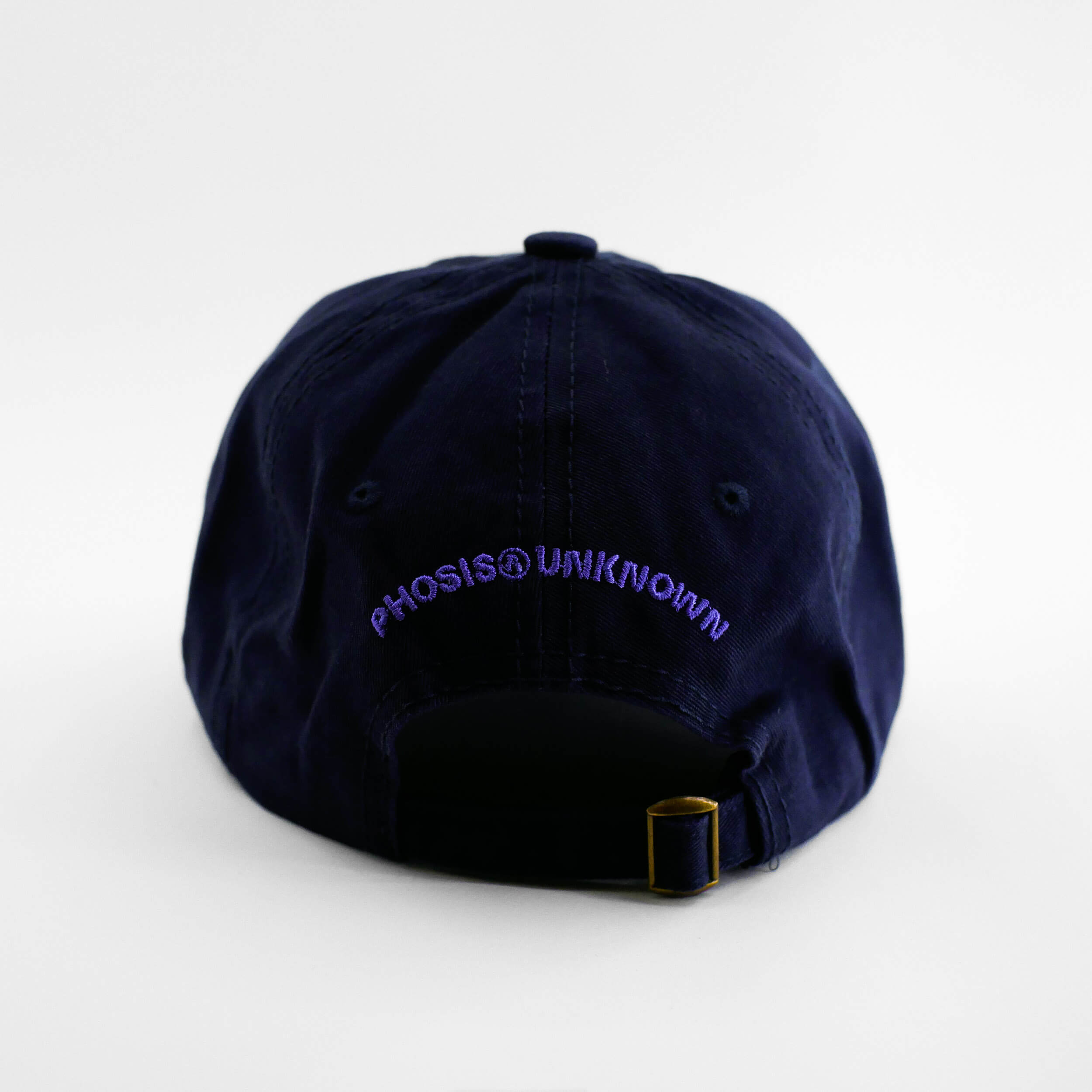 Back view of the embroidered 'FLAMBE' navy blue hat from PHOSIS Clothing