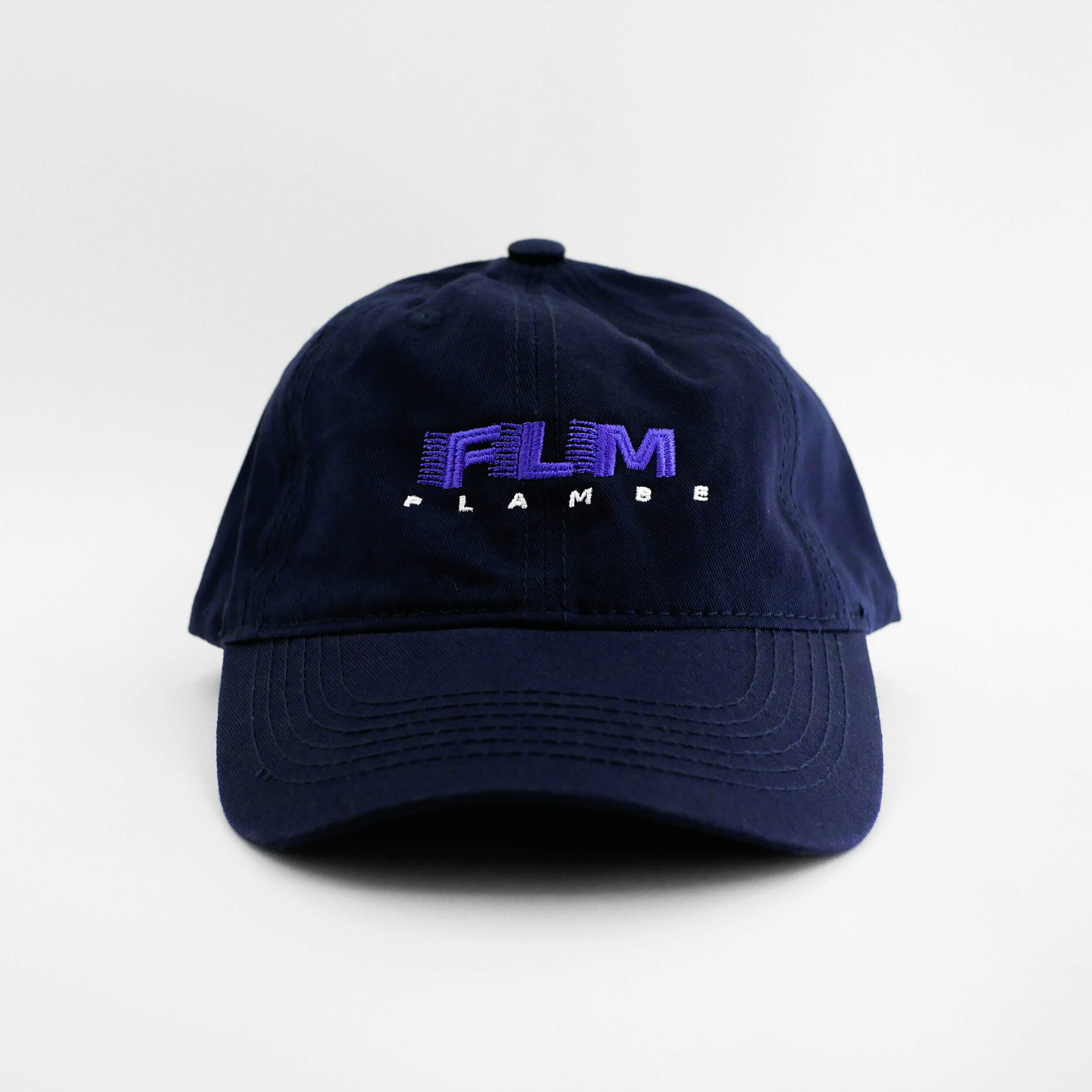 Front view of the embroidered 'FLAMBE' navy blue hat from PHOSIS Clothing