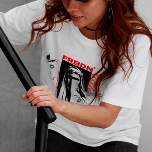 Angle view of model wearing FORBIDDEN white t-shirt from PHOSIS Clothing