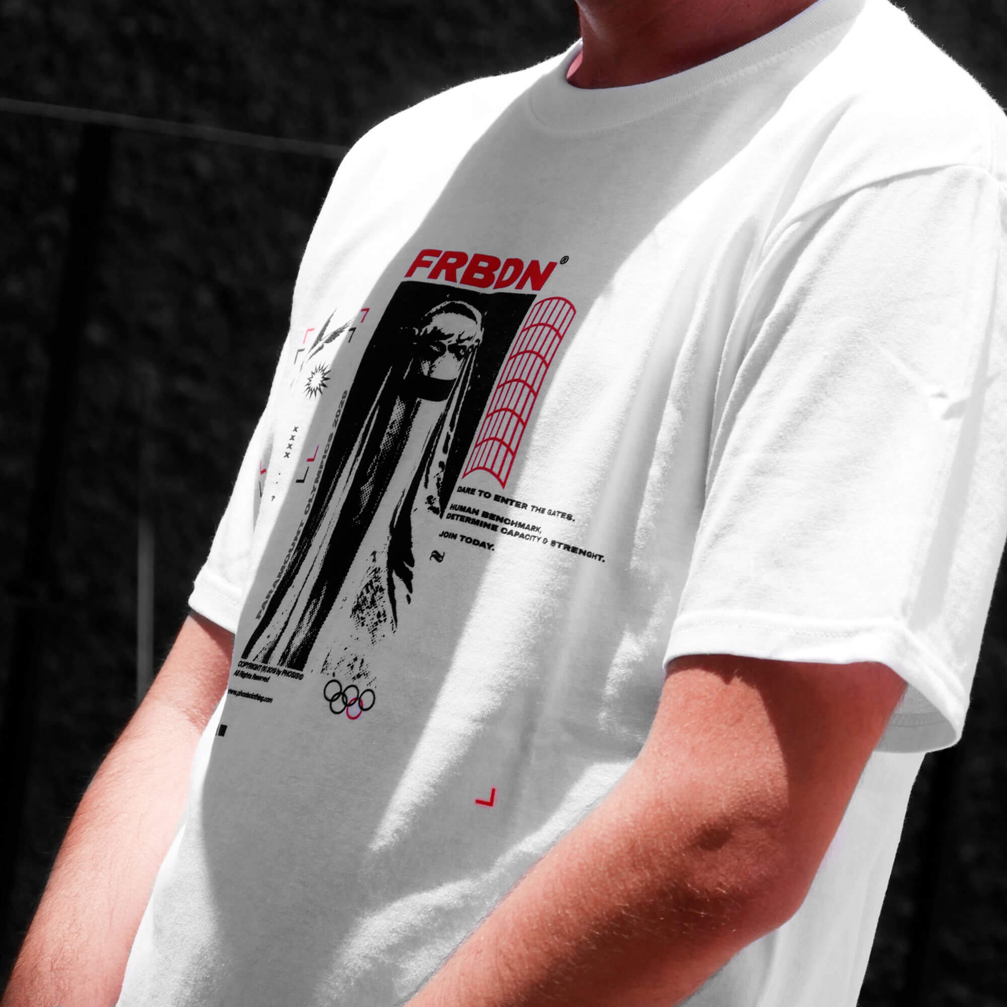 Close up view of model wearing FORBIDDEN white t-shirt from PHOSIS Clothing