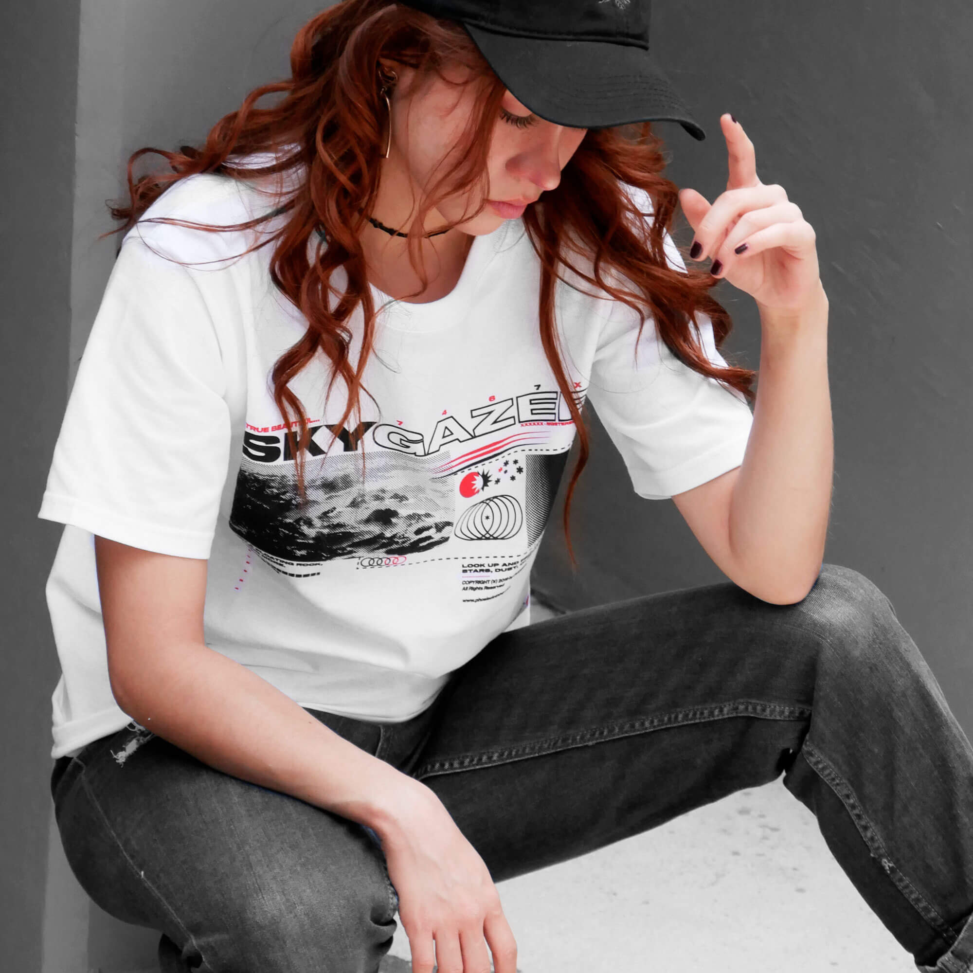 Angle view of model wearing SKYGAZER white t-shirt from PHOSIS Clothing