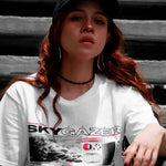 Close up view of model wearing SKYGAZER white t-shirt from PHOSIS Clothing