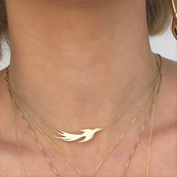 This phoenix necklace is a fierce, daily reminder of recreating ourselves and of wings spreading .  Sterling silver studded with a blue sapphire\ sensual Ruby .  Every Danielle Gerber piece is handmade. Items are made to order, therefore, please allow up to 10  business days before shipping creating your one of a kind piece.