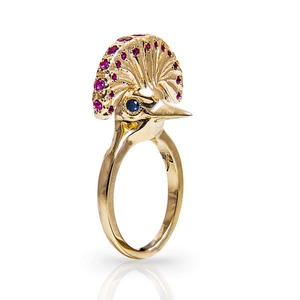 14K Gold studded with 1 ct sensual rubies and dramatic sapphires (39 stones).  Weights 10.5 grams.   The bird ring is a gentle, daily reminder for wings spreading and the freedom of choice we have.   Every Danielle Gerber piece is handmade. Items are made to order, therefore, please allow us up to 10  business days before shipping.