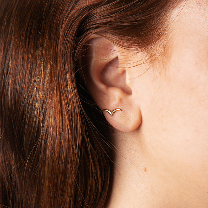 THESE EARRINGS CONTAIN MAGIC.    Sterling Silver studs.  Every Danielle Gerber piece is handmade. Items are made to order, therefore, please allow us up to 10  business days before shipping