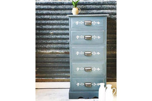 Tall chest of drawers. Hand painted in Milk paint in Aviary, a smokey blue. White floral stencil added to drawer fronts. Vintage. Hand painted. 5 drawers, pewter file handles with label space.