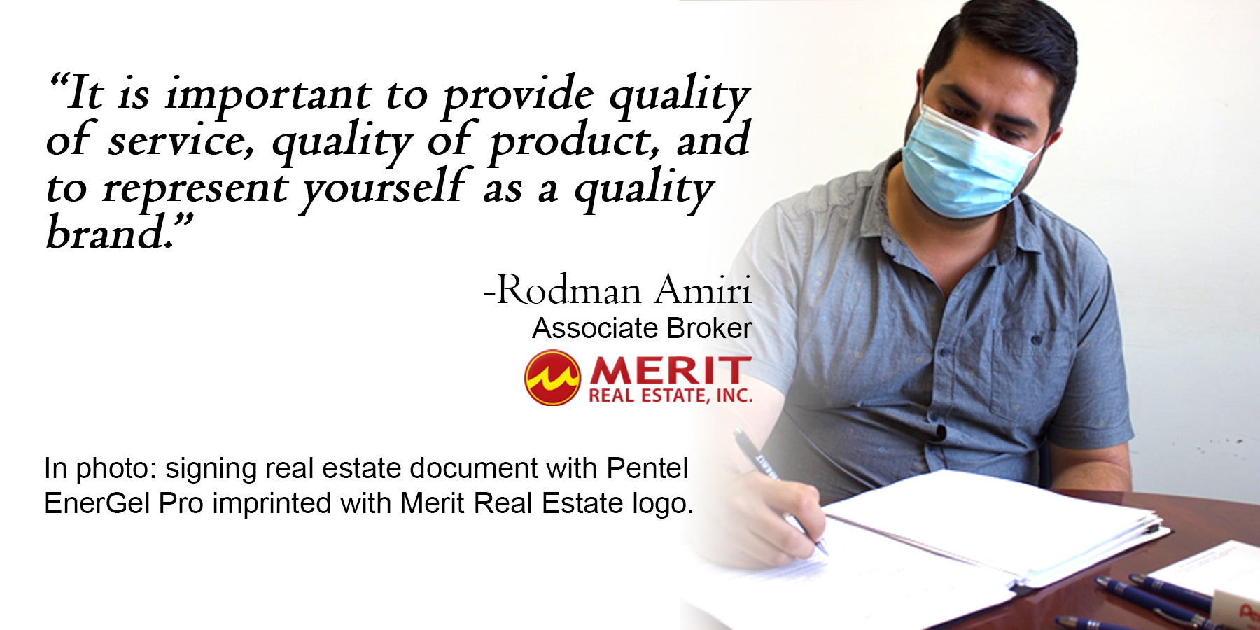 Rodman signing real estate document with Pentel EnerGel Pro imprinted with Merit Real Estate logo.