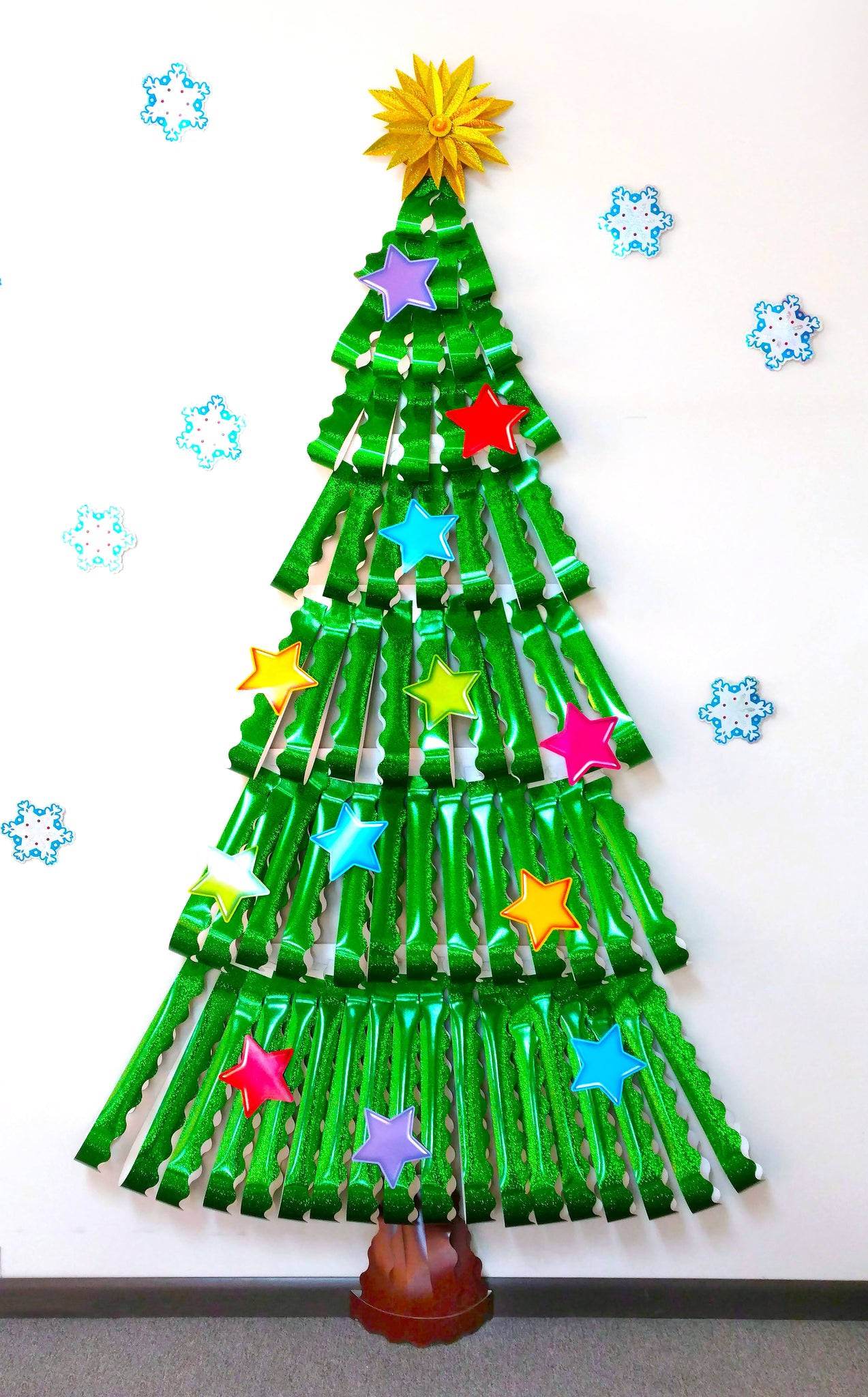 Christmas tree classroom wall decoration made from sparkle trimmers.