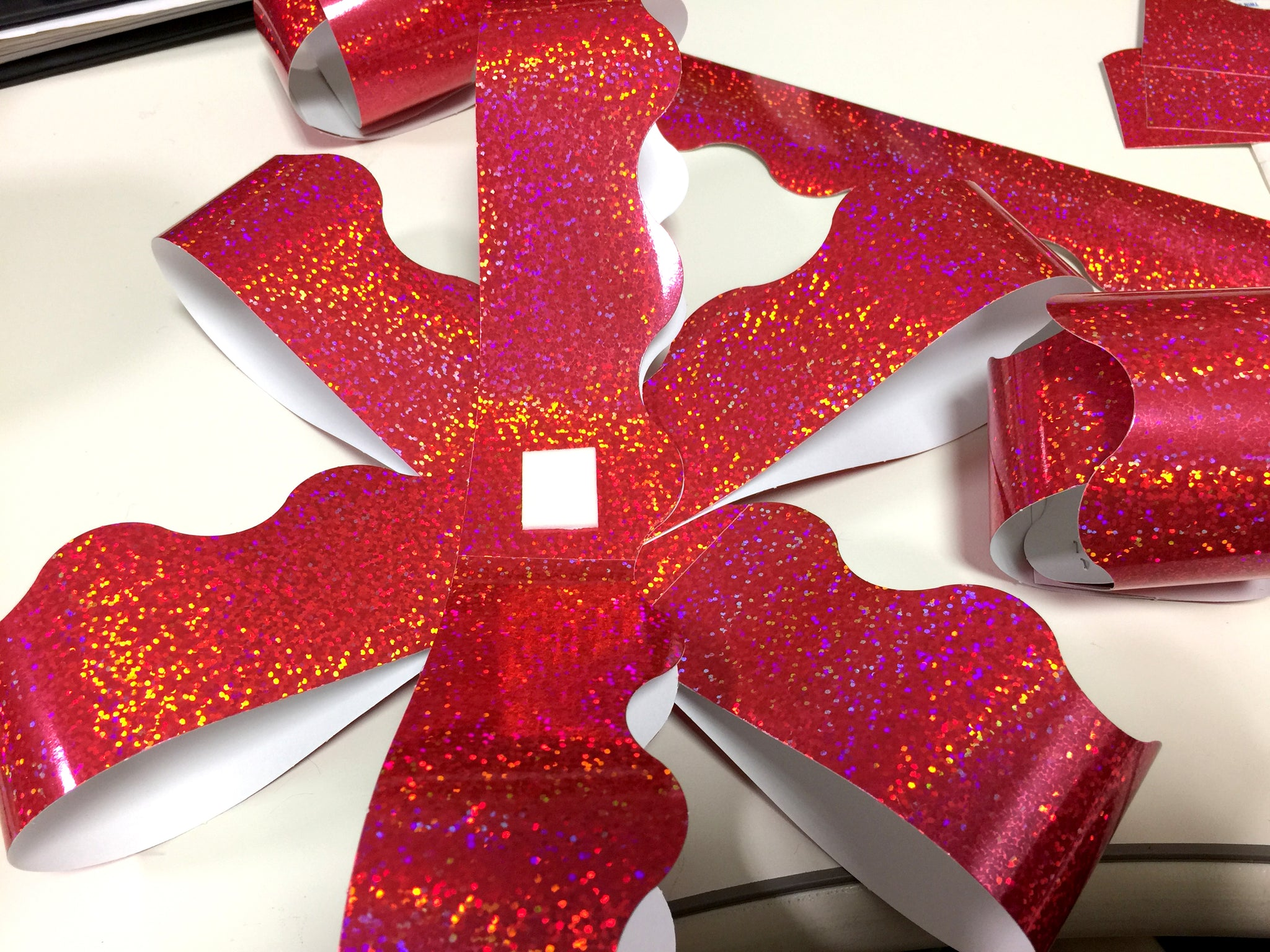 How to make a DIY paper bow for Christmas.