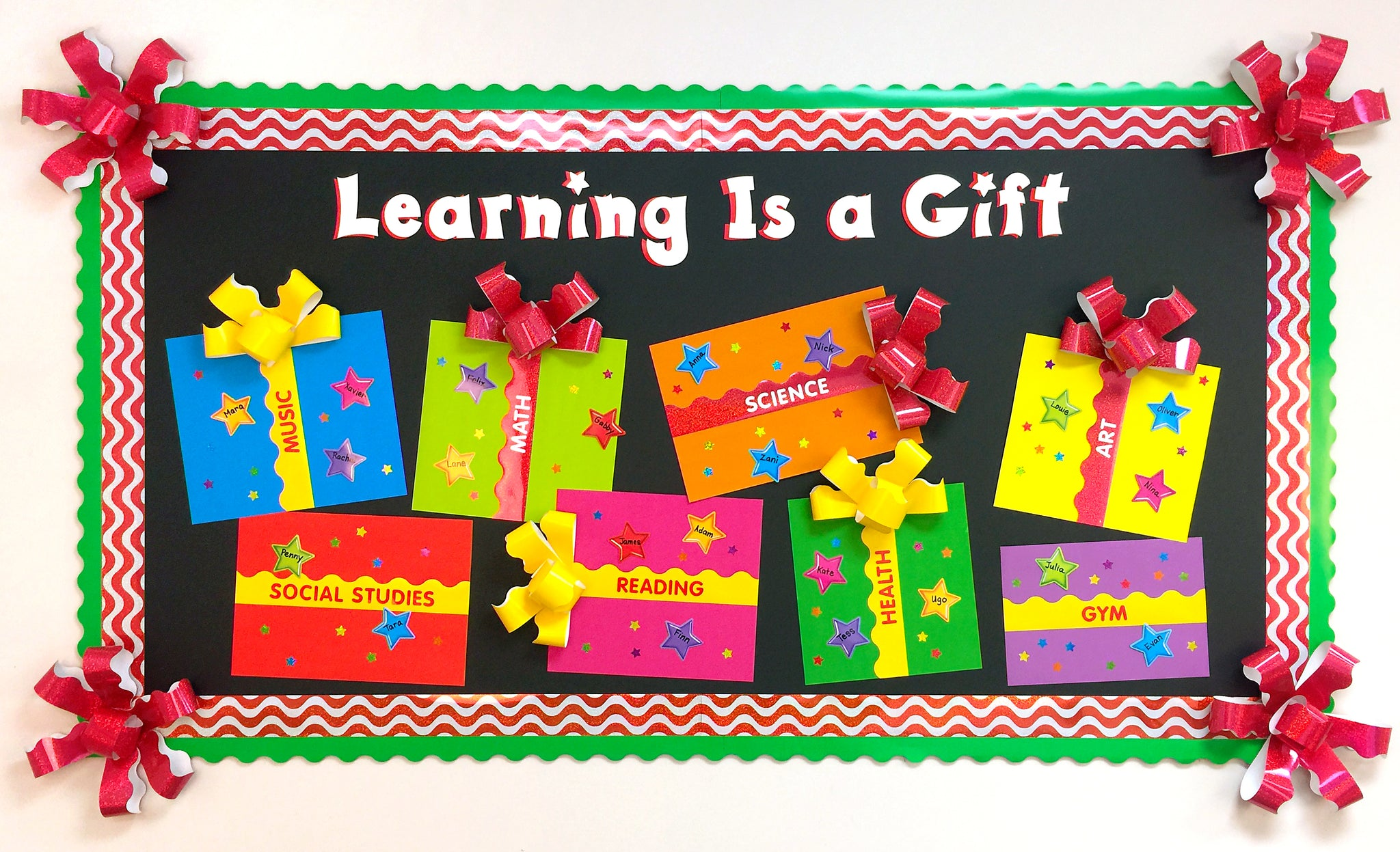 Learning is a gift Christmas holiday bulletin board idea.