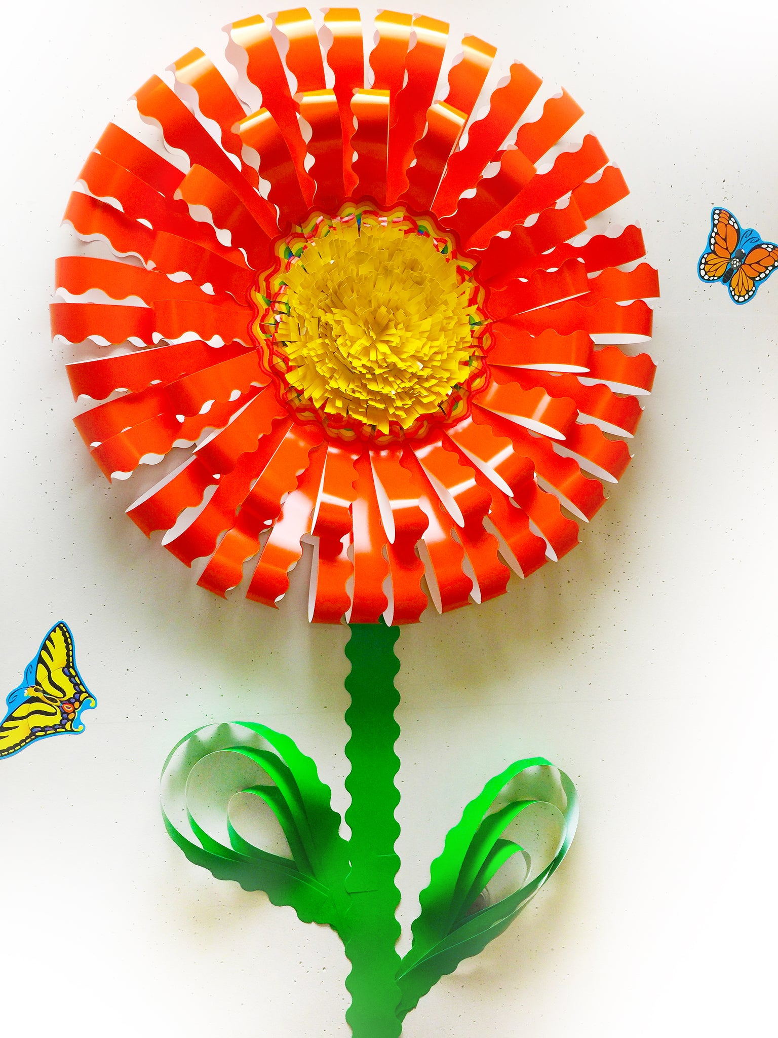 giant paper flower made from bulletin board borders trimmers trend